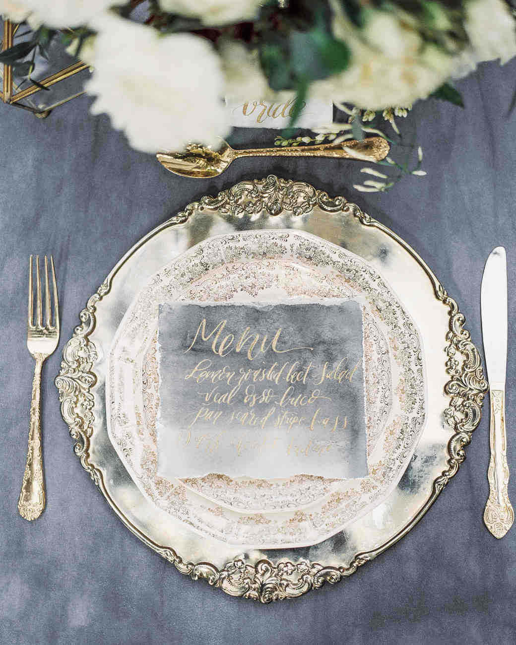 silver place setting with calligraphy menu