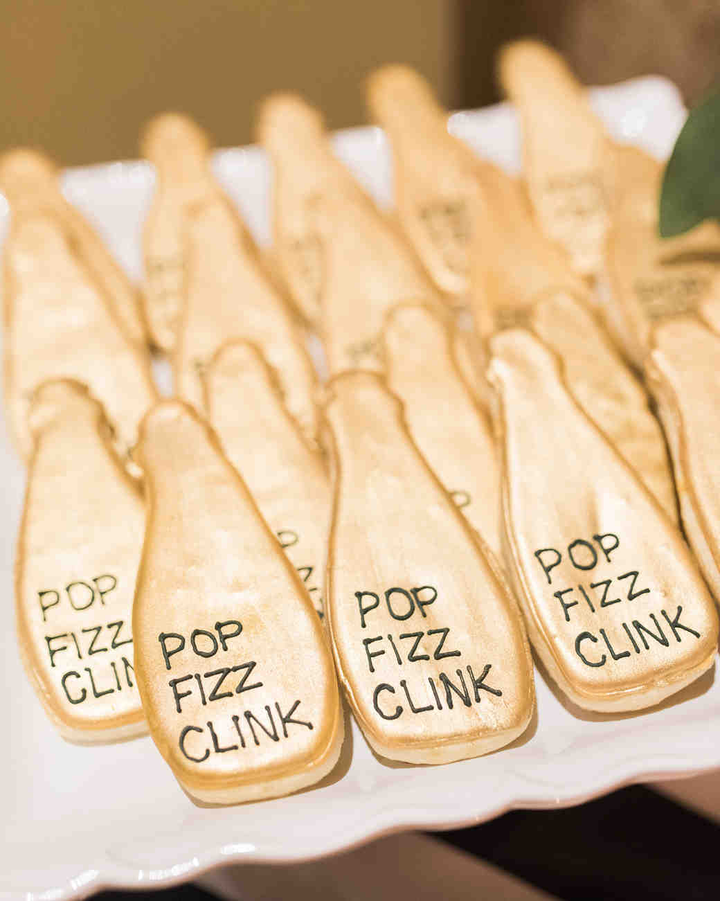 champagne shaped gold frosted cookies