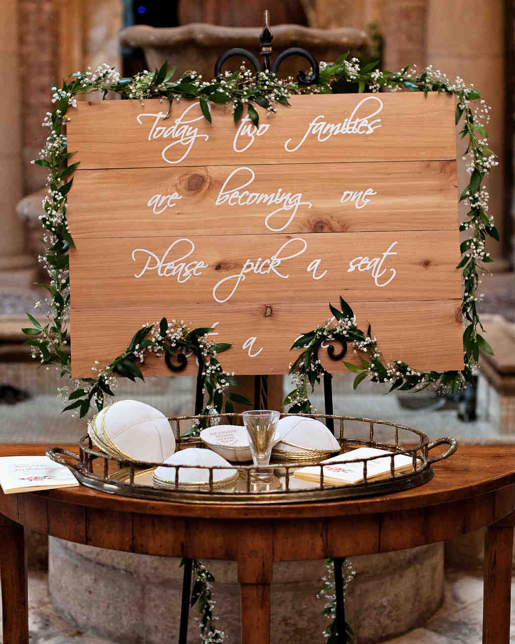 gold-rimmed yarmulkes rustic wood sign with babys breath