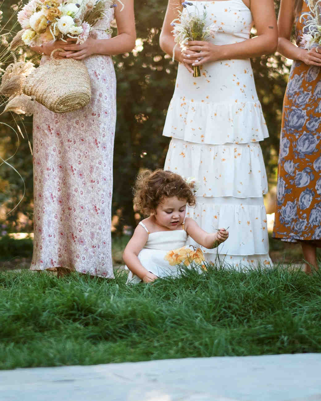 anika max wedding flower girl in grass with bridesmaids