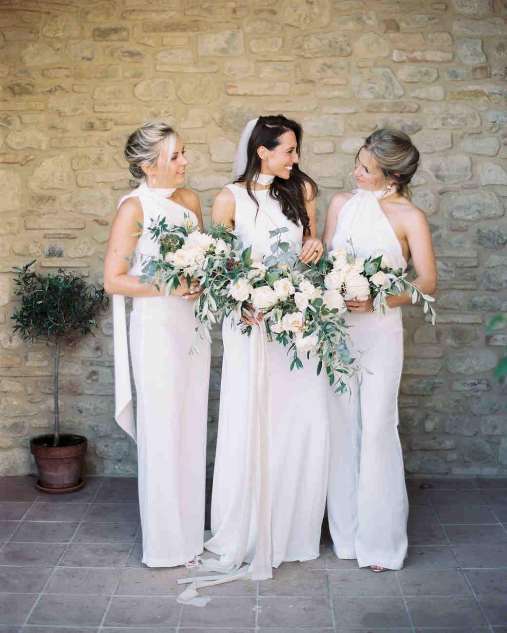 women wearing white high neckline bridesmaids jumpsuits