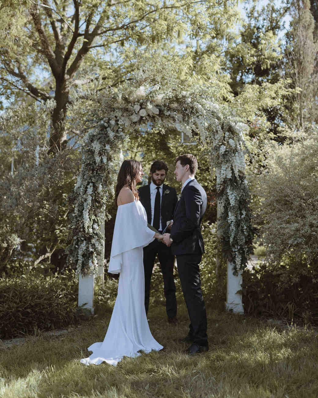 flower arch wedding ceremony in garden