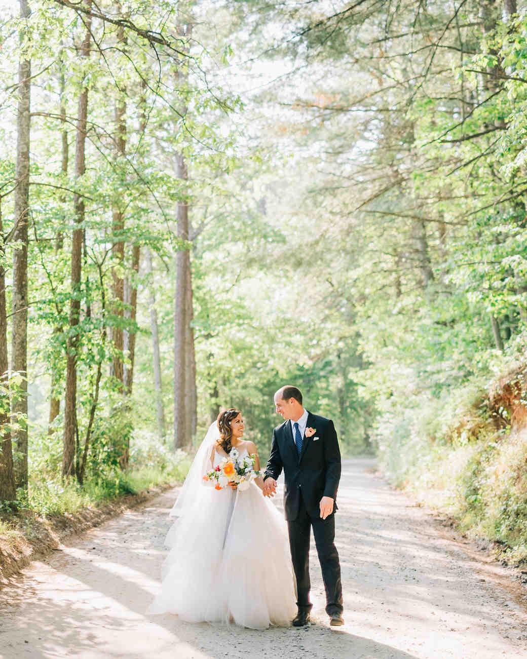 elizabeth jake georgia wedding couple walking through forest