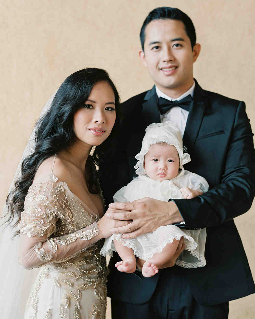 emme daji wedding couple with baby daughter