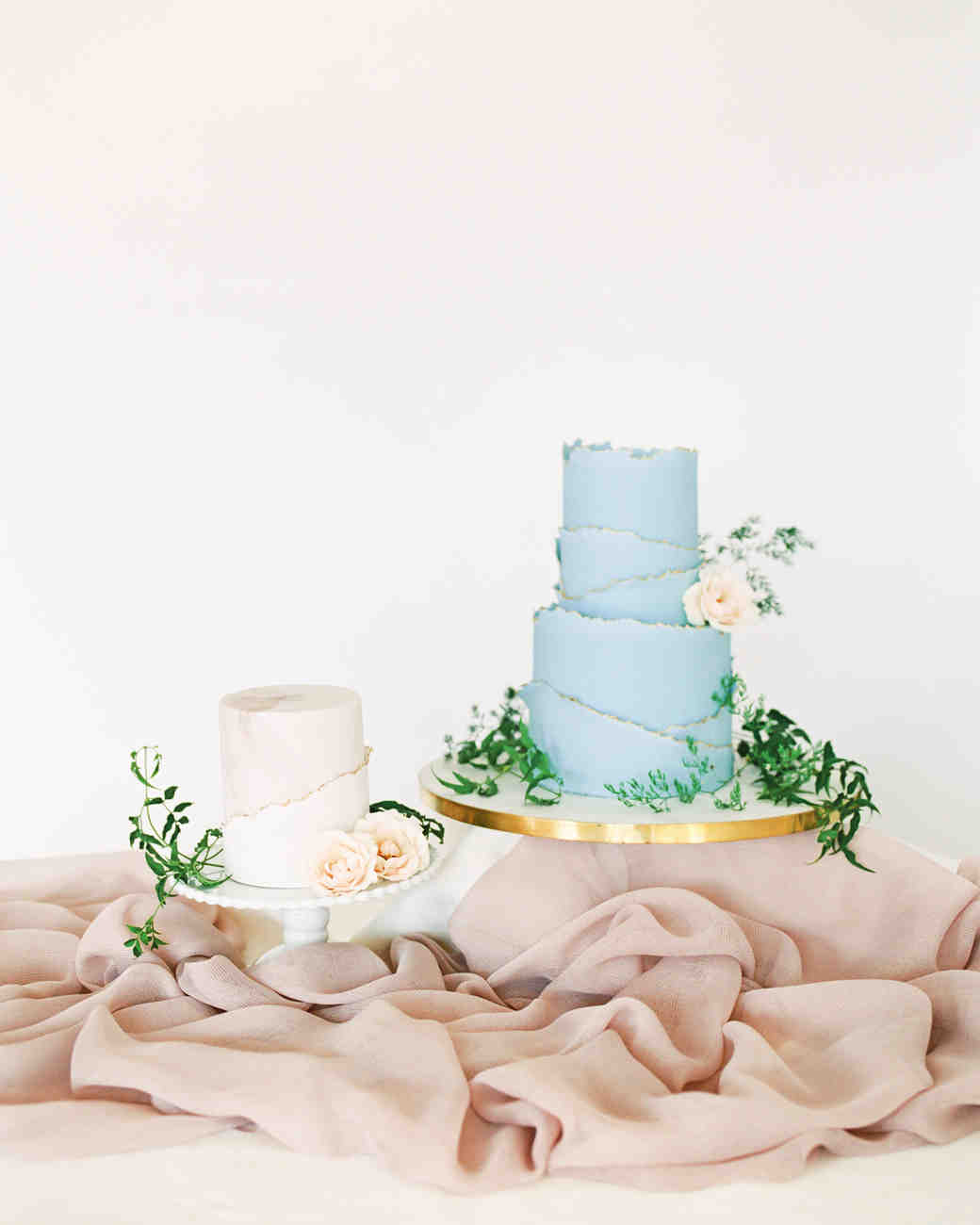 blue and white wedding cakes with deckled edges