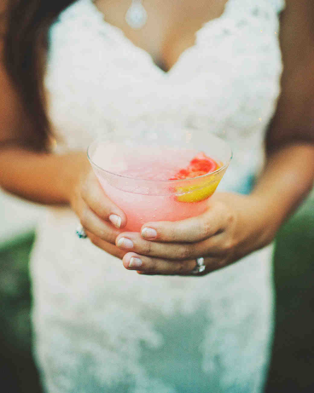 bride holding frozen drink