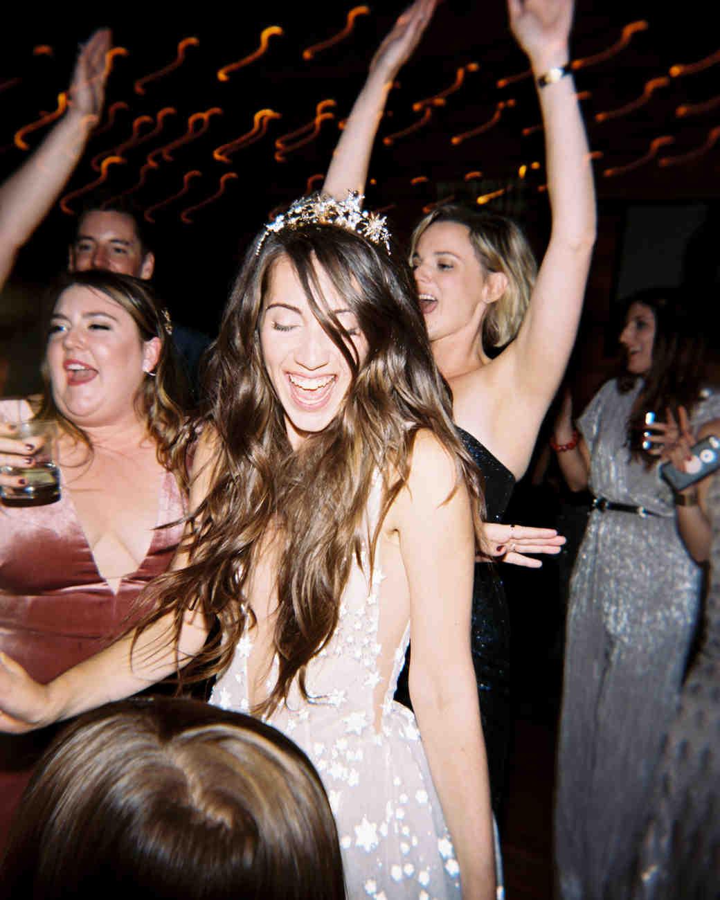 bride wearing star crown dancing