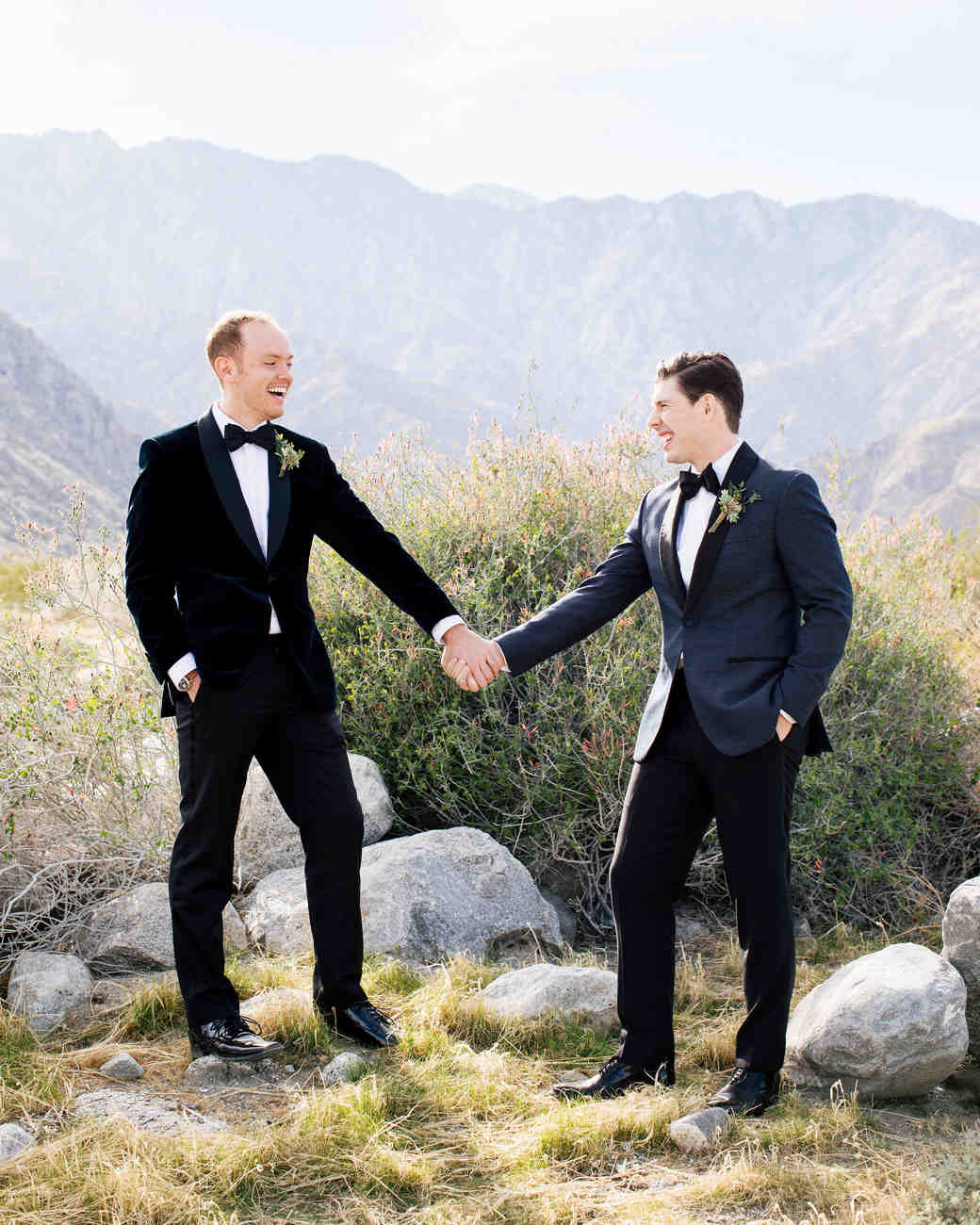 michael thomas wedding grooms holding hands outdoors