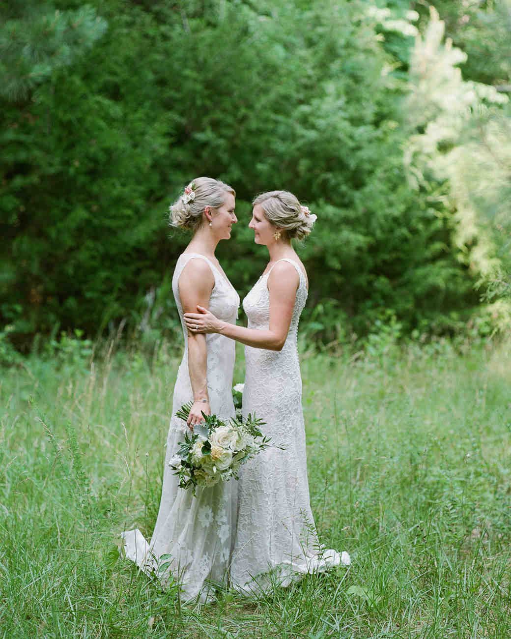 paige and kristine wedding brides embracing in field