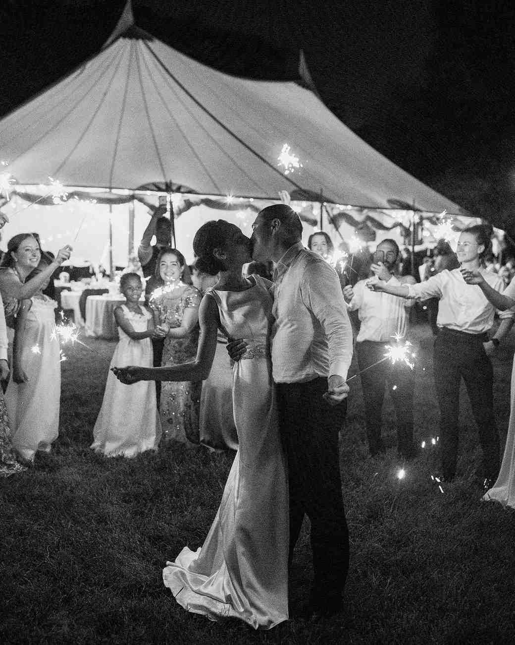 pillar paul wedding sparklers couple kissing