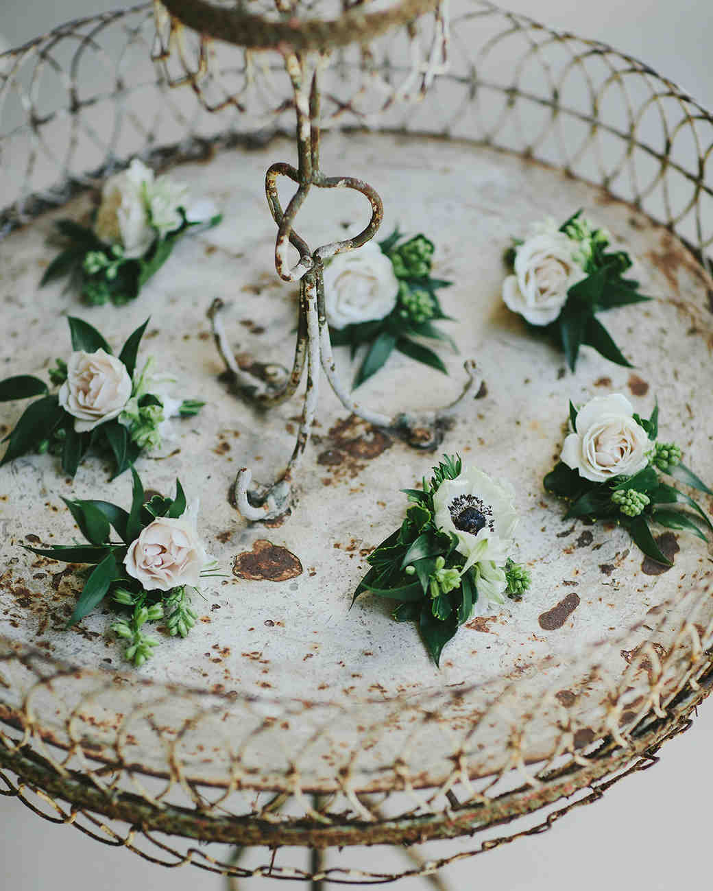 sarah daniel wedding boutonnieres on antique tray