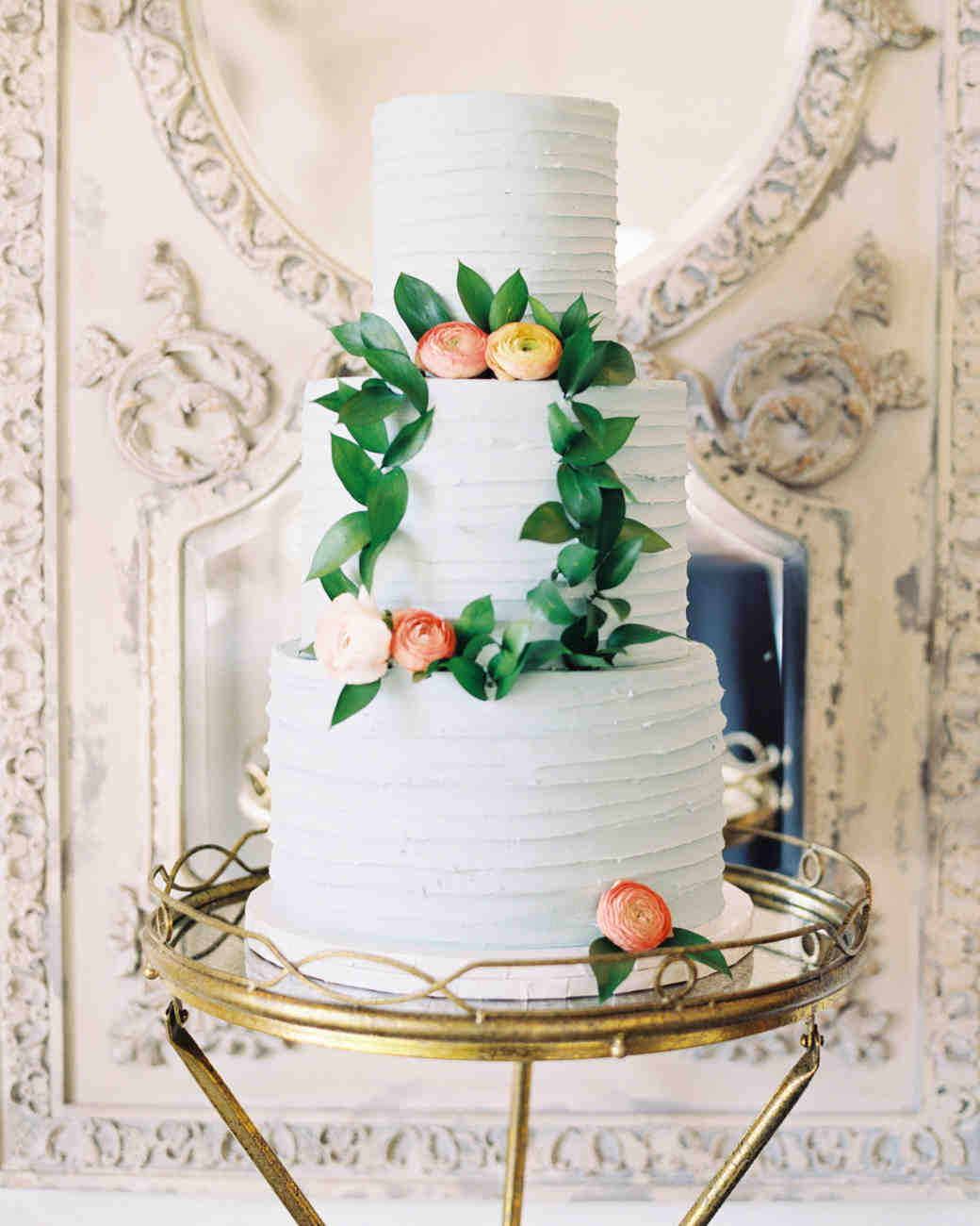 three tier cake sitting on gold stand