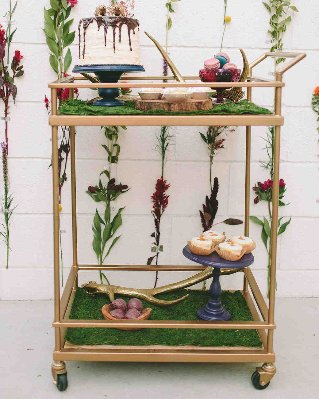greenery-filled wedding bar cart