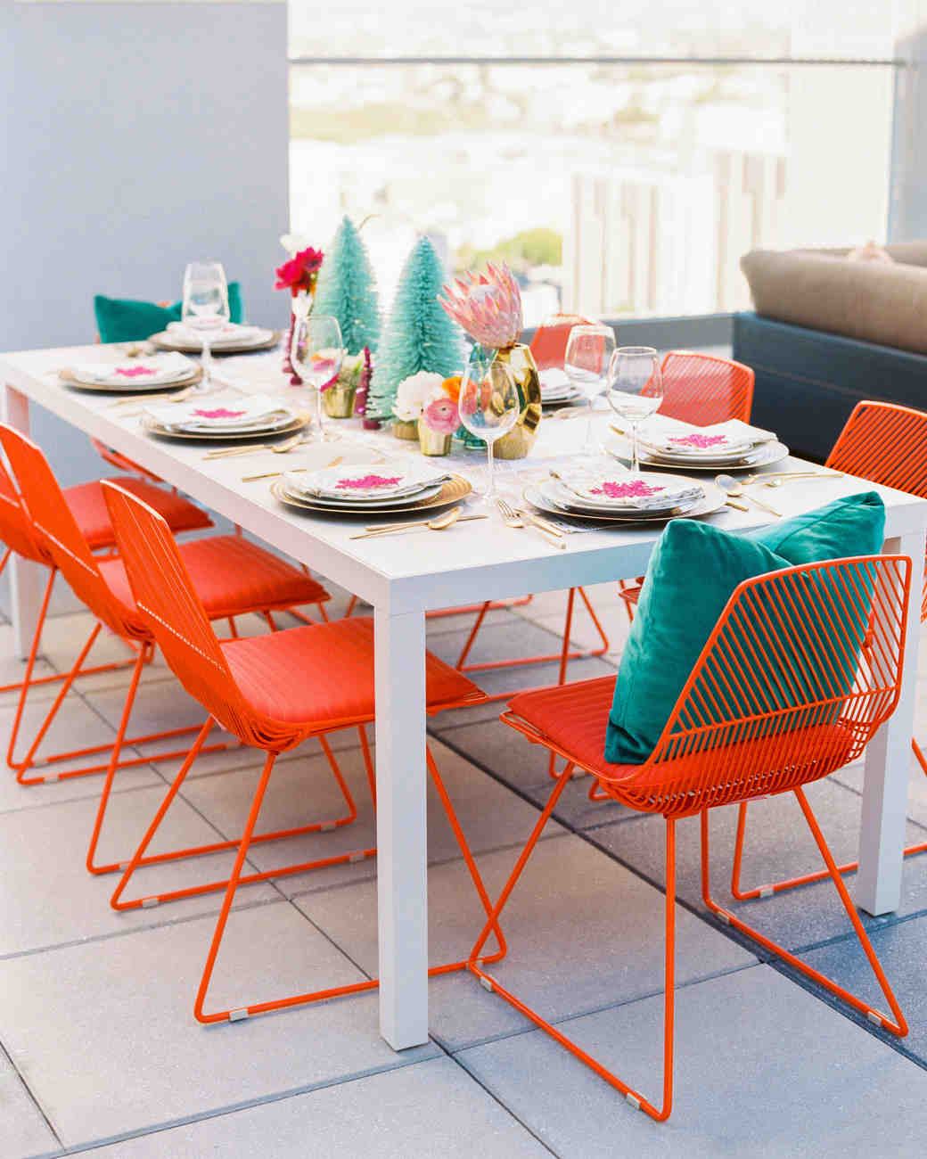winter rehearsal dinner modern tablescape with orange seating