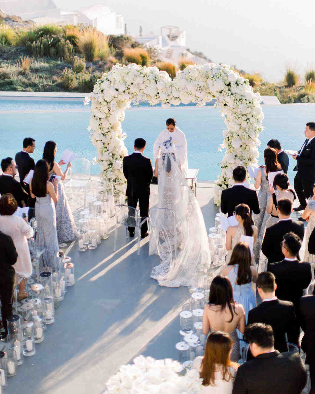 angie prayogo greece wedding outdoor ceremony couple flower arch