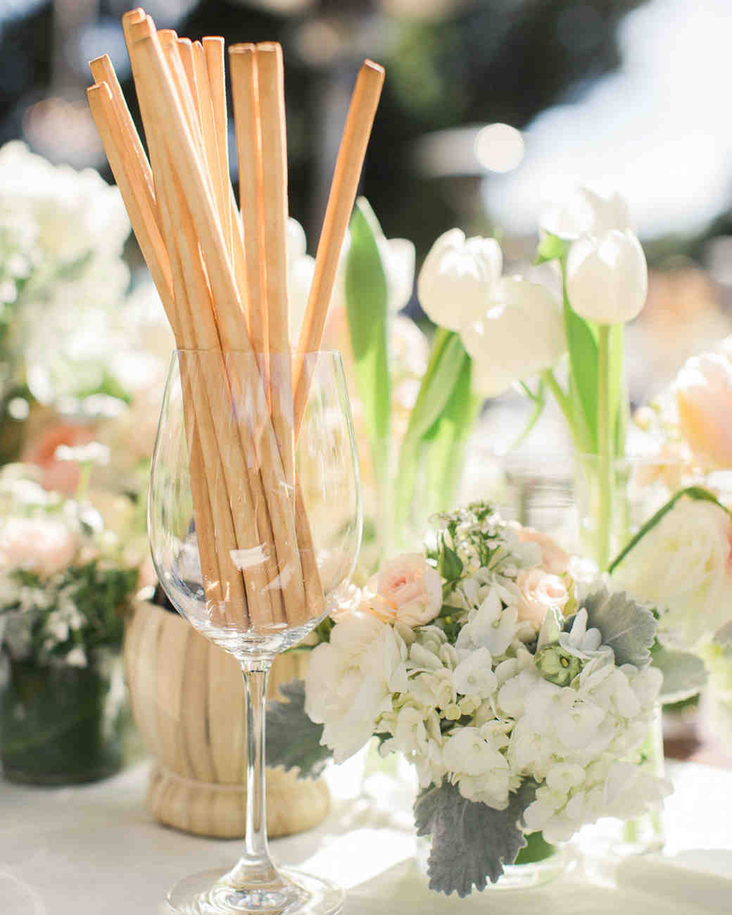 bread sticks in wine glass on table