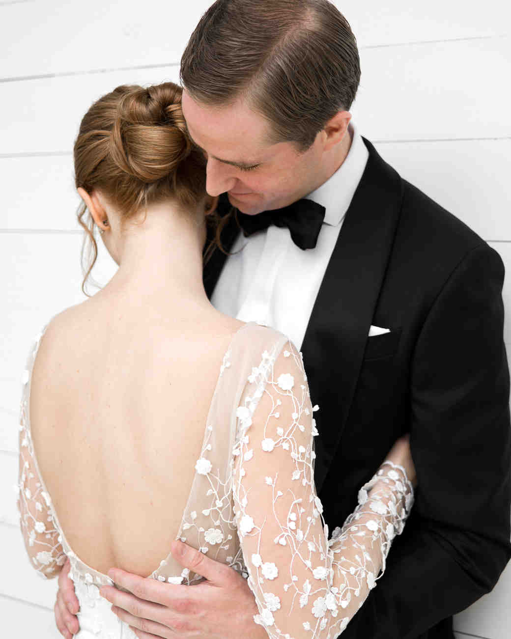 brittany peter wedding couple hugging bride backless dress