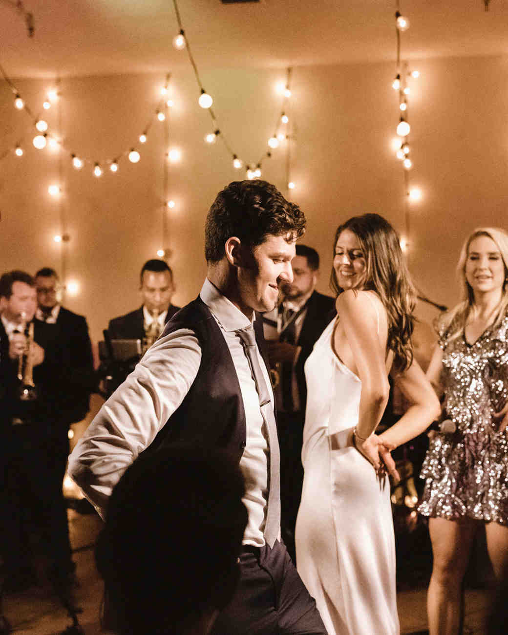 guests watch bride and groom share first dance