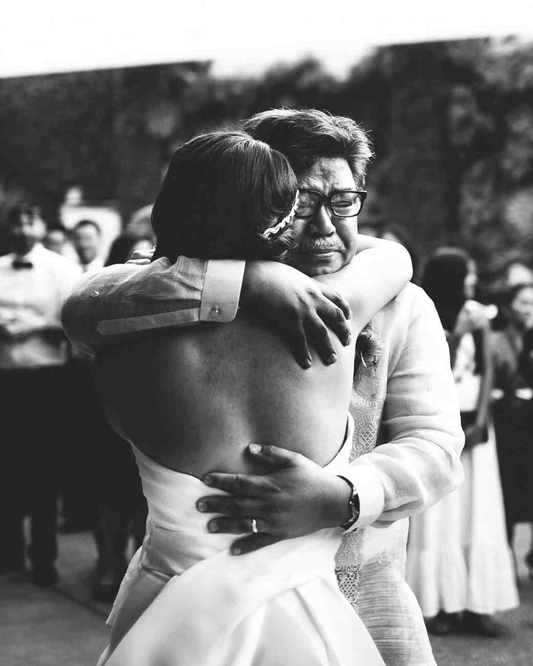 dad daughter wedding moment hug emotional