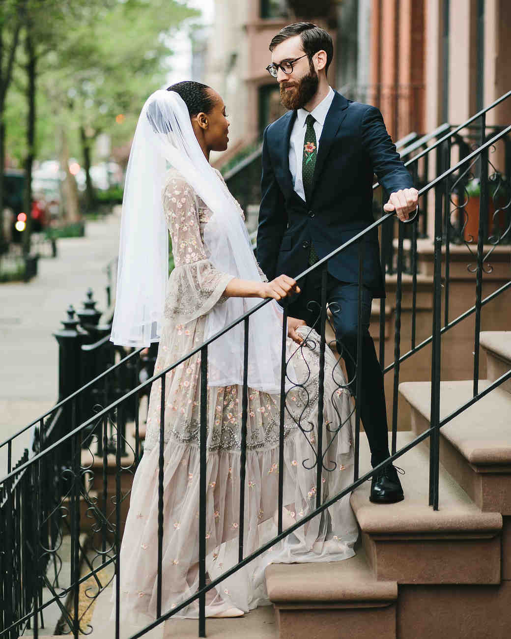 lola quinlan elopement couple gaze on stairs