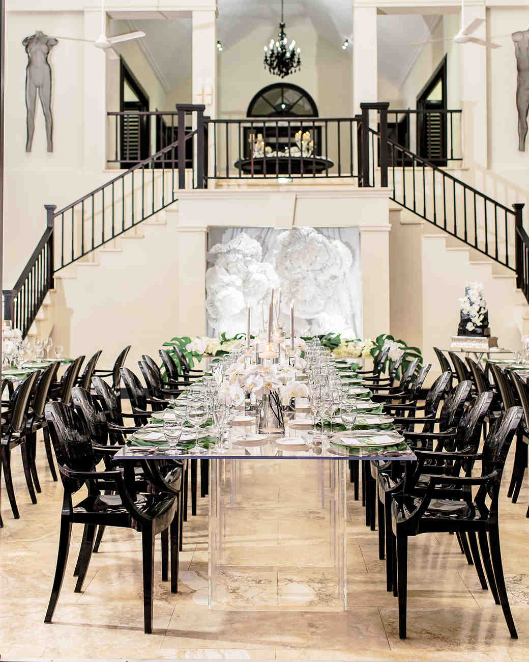 melissa leighton wedding reception long table with black chairs