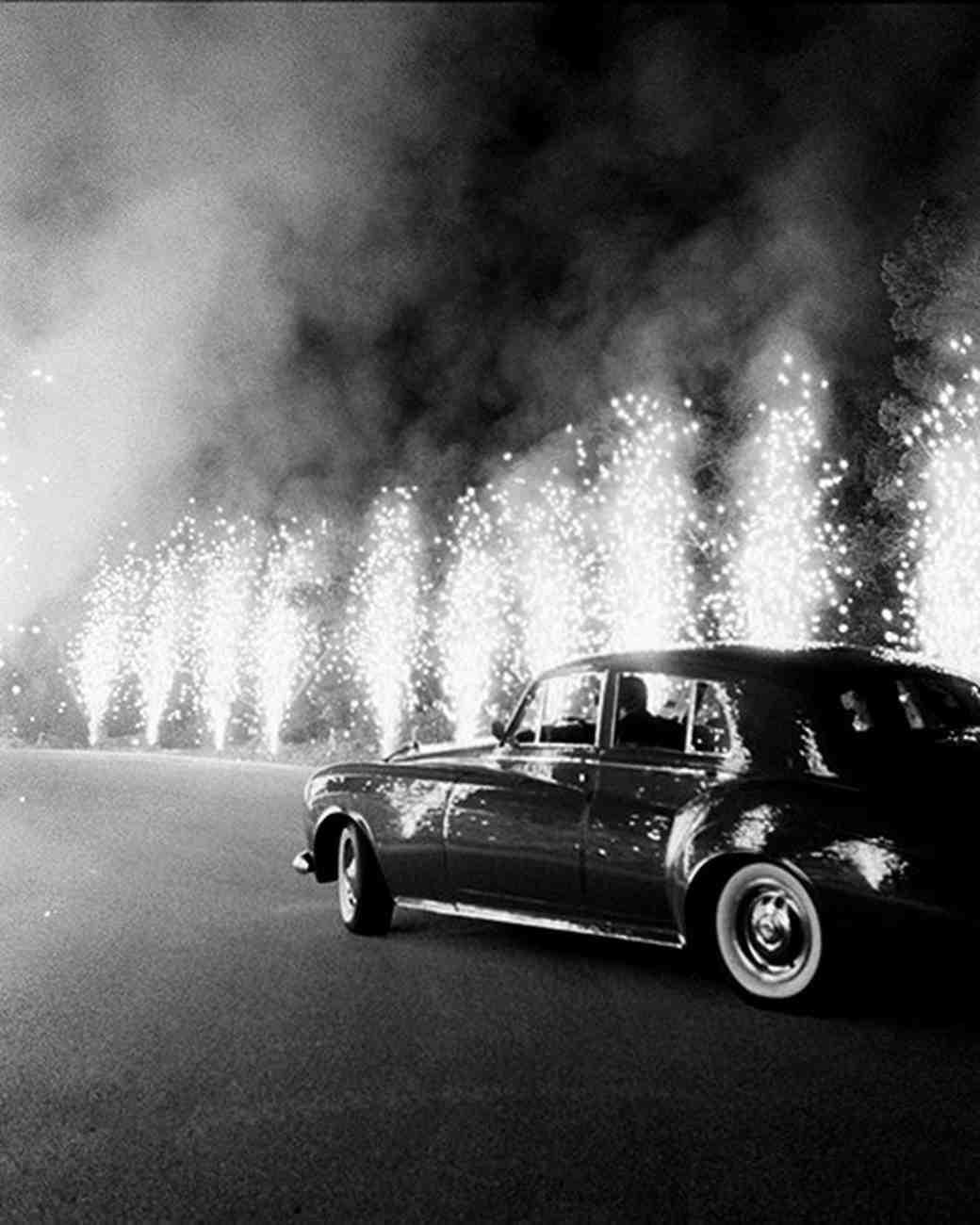 night wedding idea sparklers and a classic car