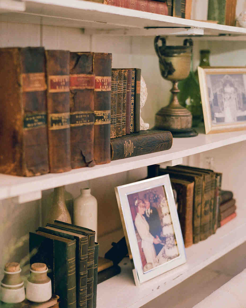 sloan scott wedding antiques on shelves in lounge area