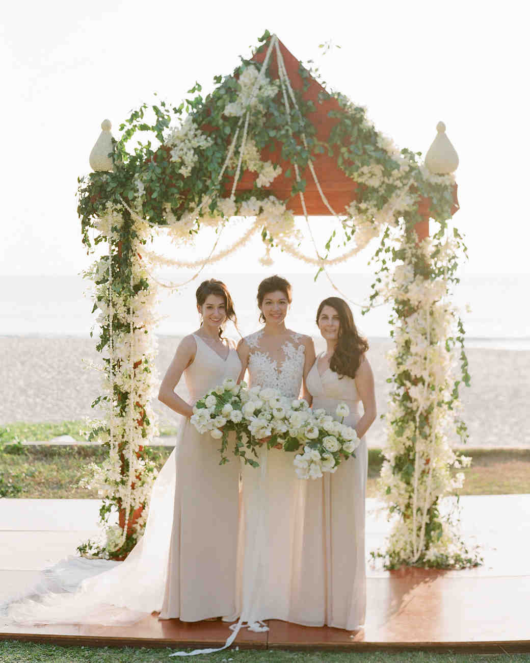 stacy brad wedding thailand bridesmaids under arch on the beach
