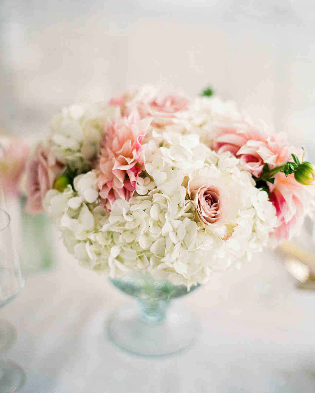 Pink dahlia and white hydrangea wedding centerpiece