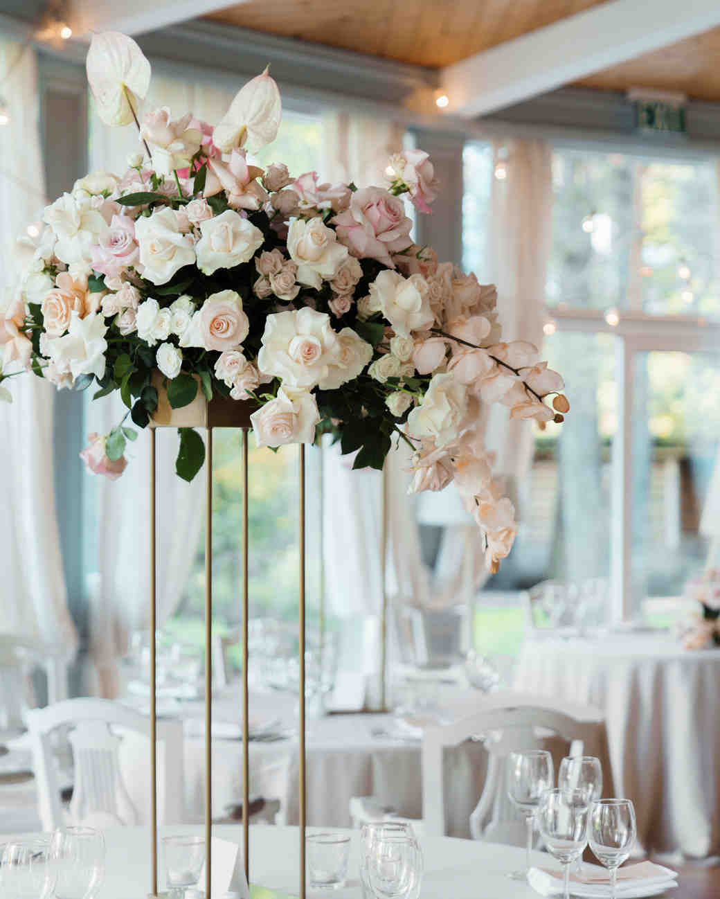 29 tall centerpieces that will take your reception tables to new rh marthastewartweddings com wedding centerpieces tall vases pictures wedding centerpieces tall vases pictures