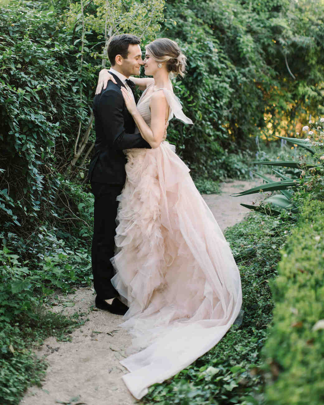 wedding couple portraits embrace greenery
