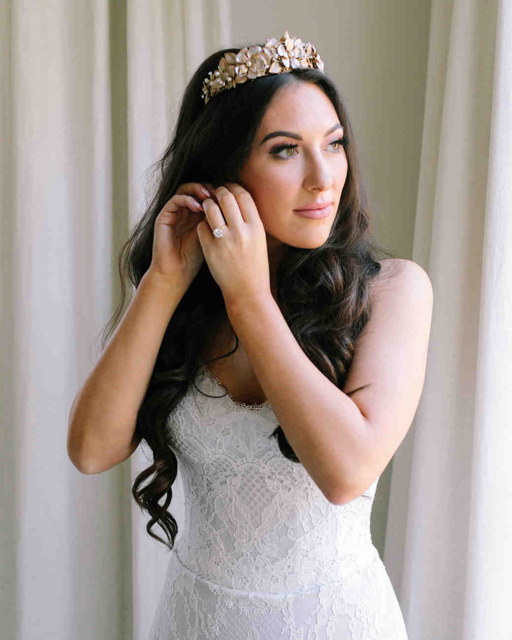 bride wearing crown with mixed gold-and-silver finishes