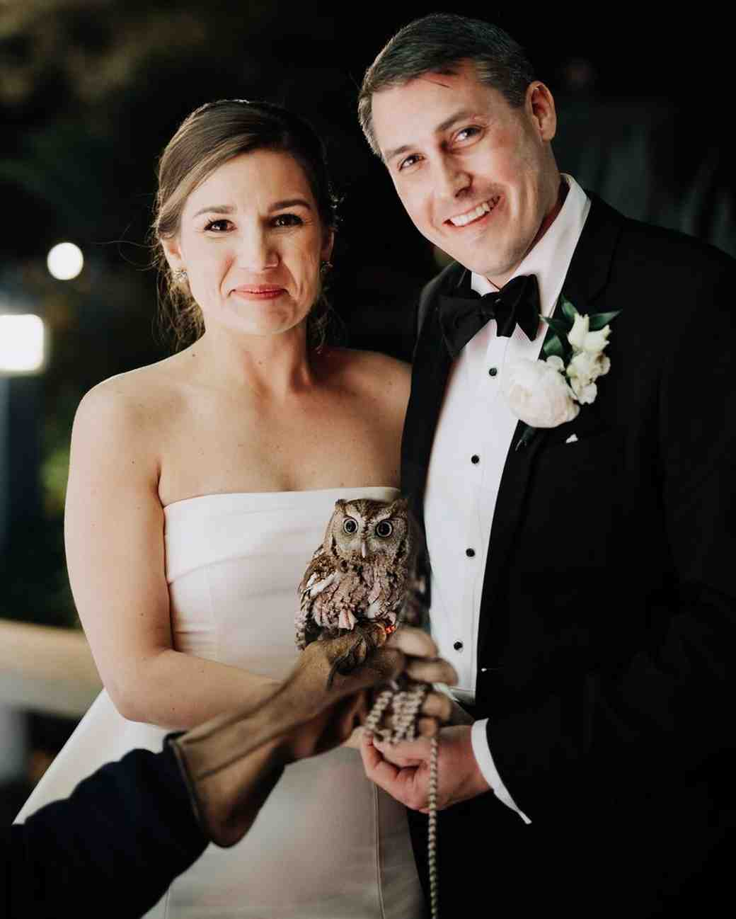 cathleen and winston wedding bride and groom posing with owl
