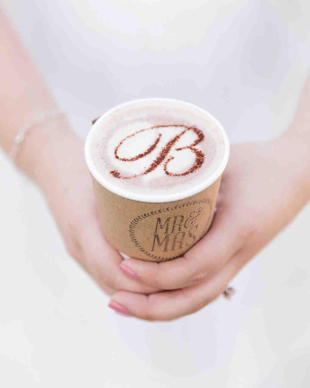 coffee wedding ideas woman holding monogrammed foam