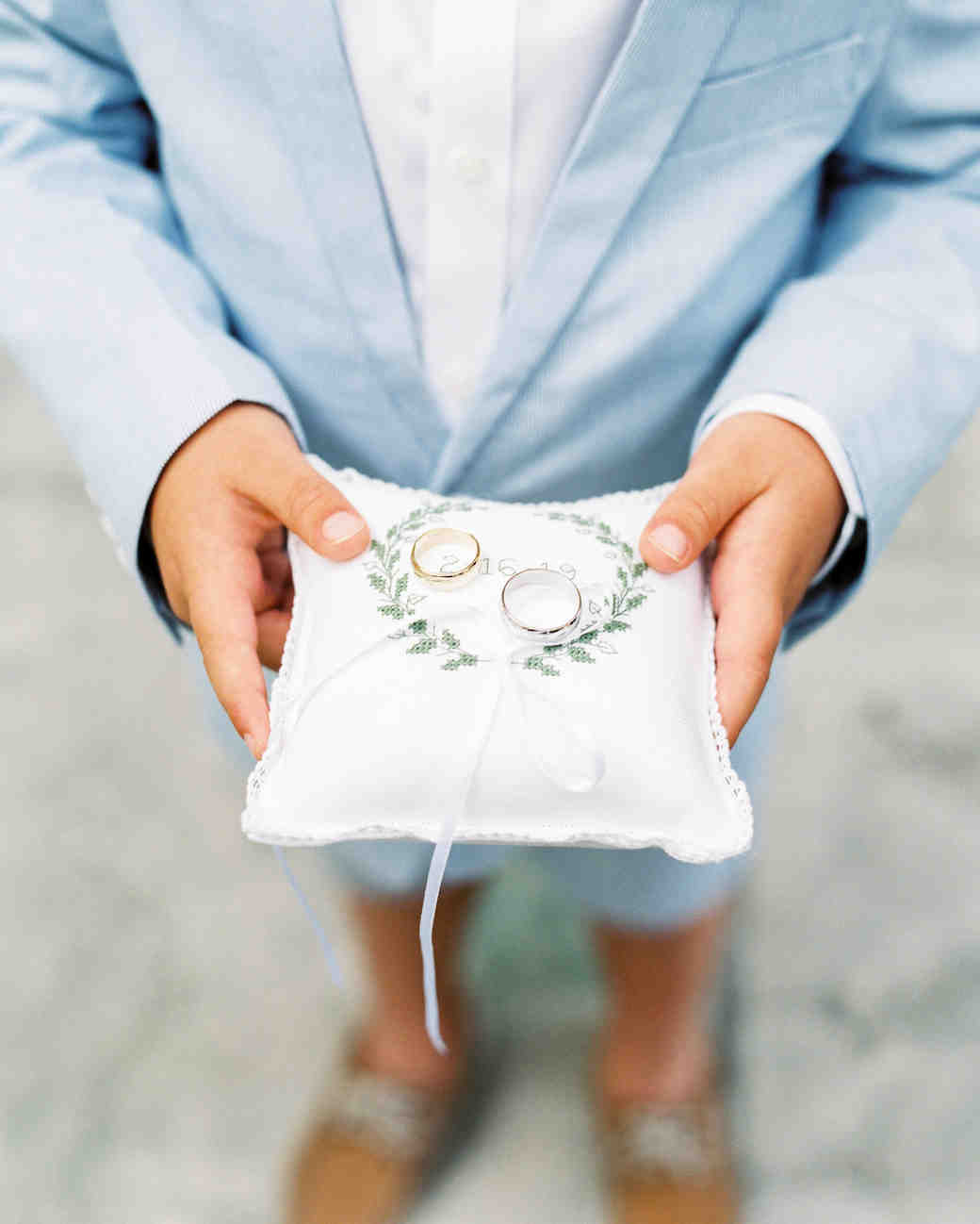 ring bearer holding pillow with rings
