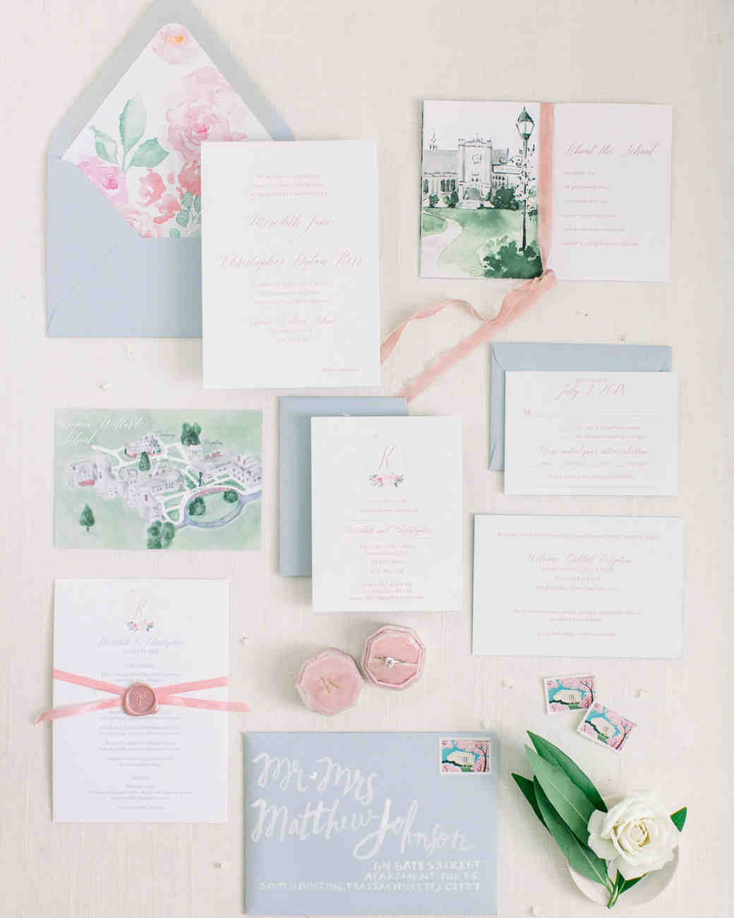blue and white stationery with floral liner and venue drawings