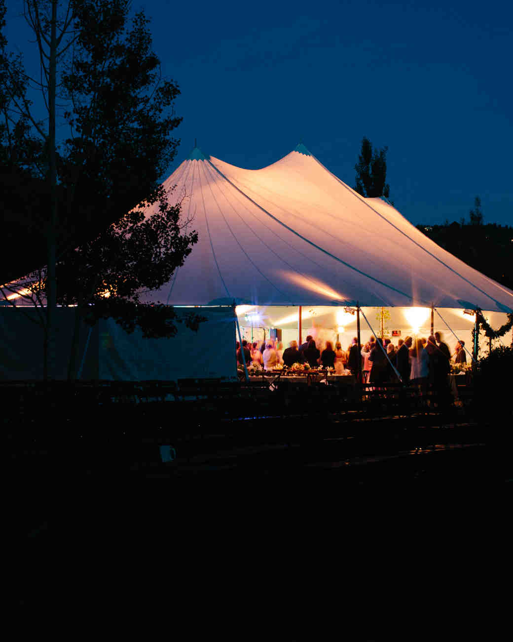 tented wedding reception at night