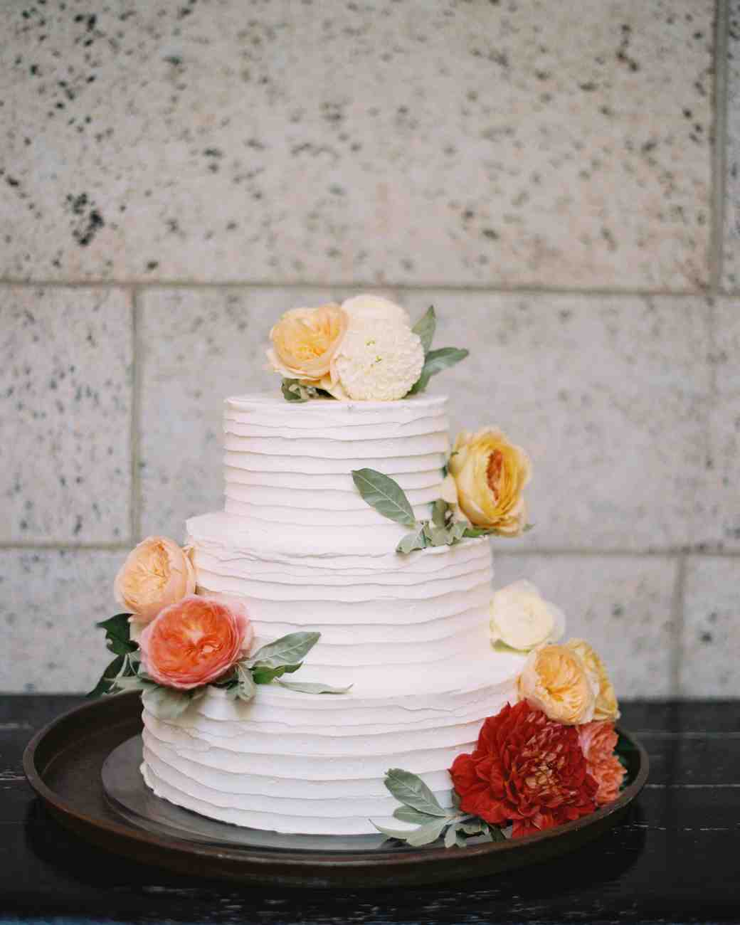 Three-Tiered White Wedding Cake with Zinnias and Roses