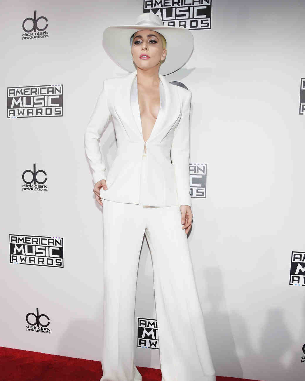 Lady Gaga wearing a white suit on the 2016 AMA red carpet