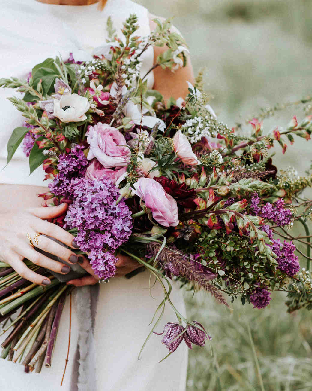 A Bride Holding a Purple Lilac Bouquet