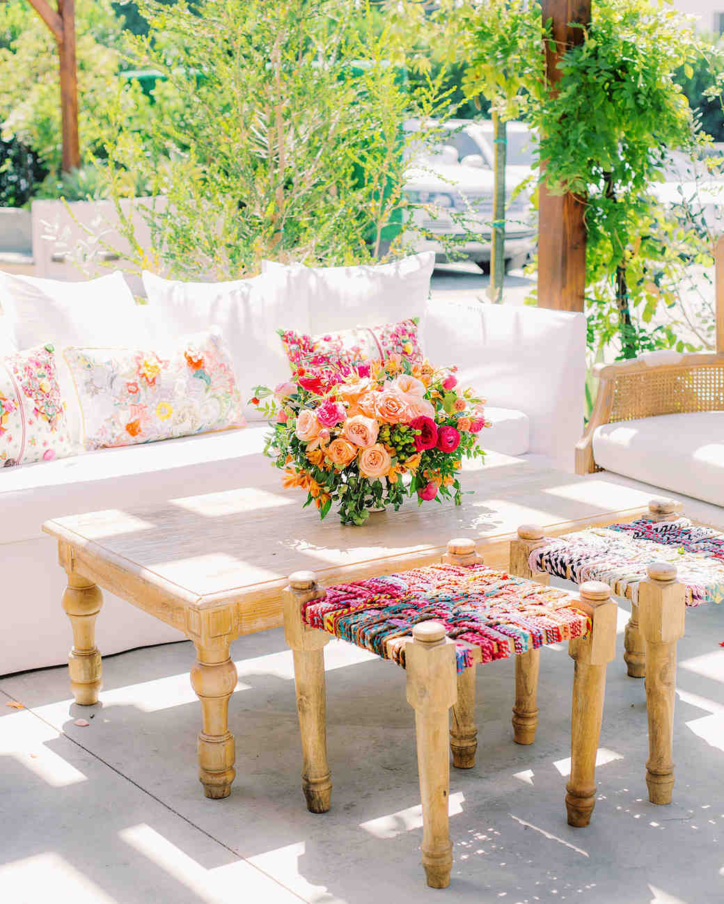 wedding lounge with neon pillows and centerpiece