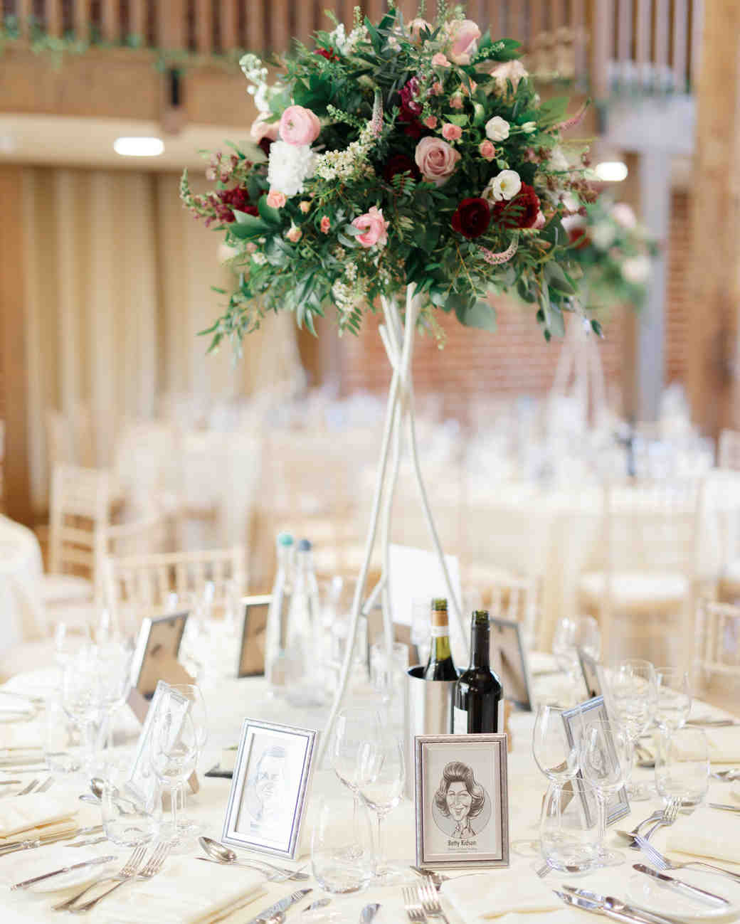 ryan thomas wedding reception white table with caricatures and floral centerpiece