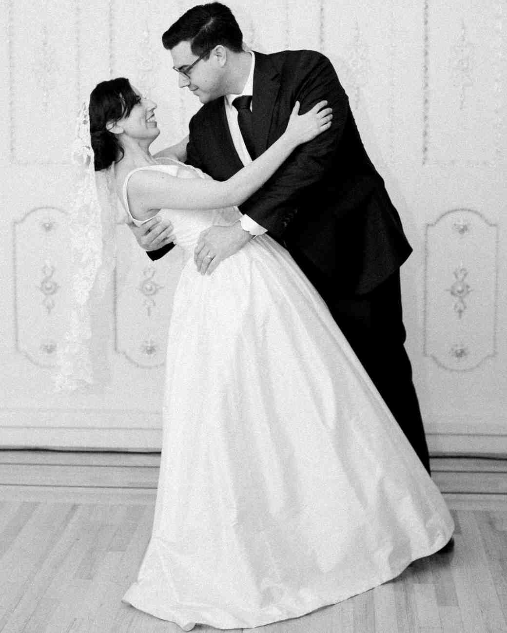 bride and groom pose during first dance