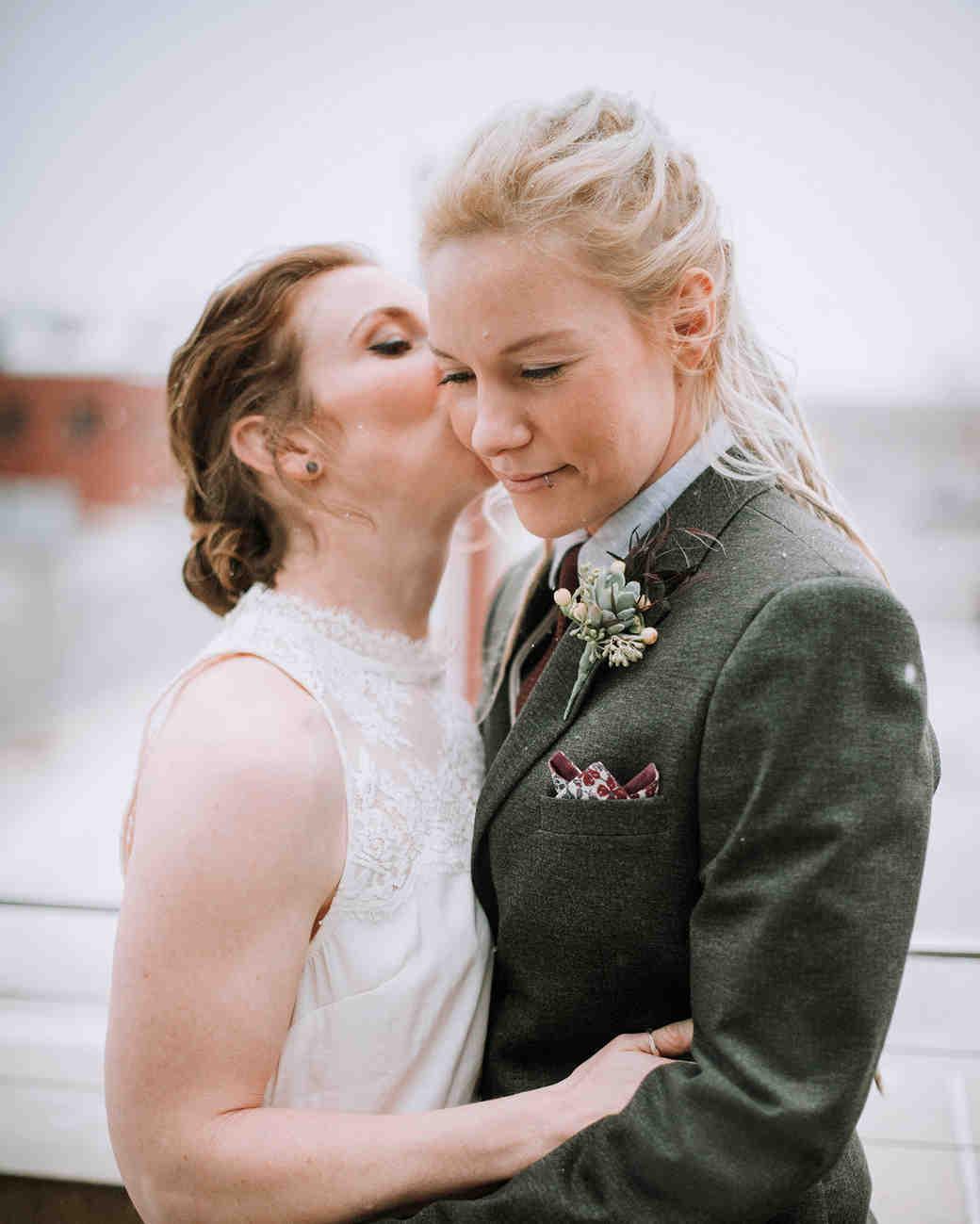 bride kissing wife on cheek