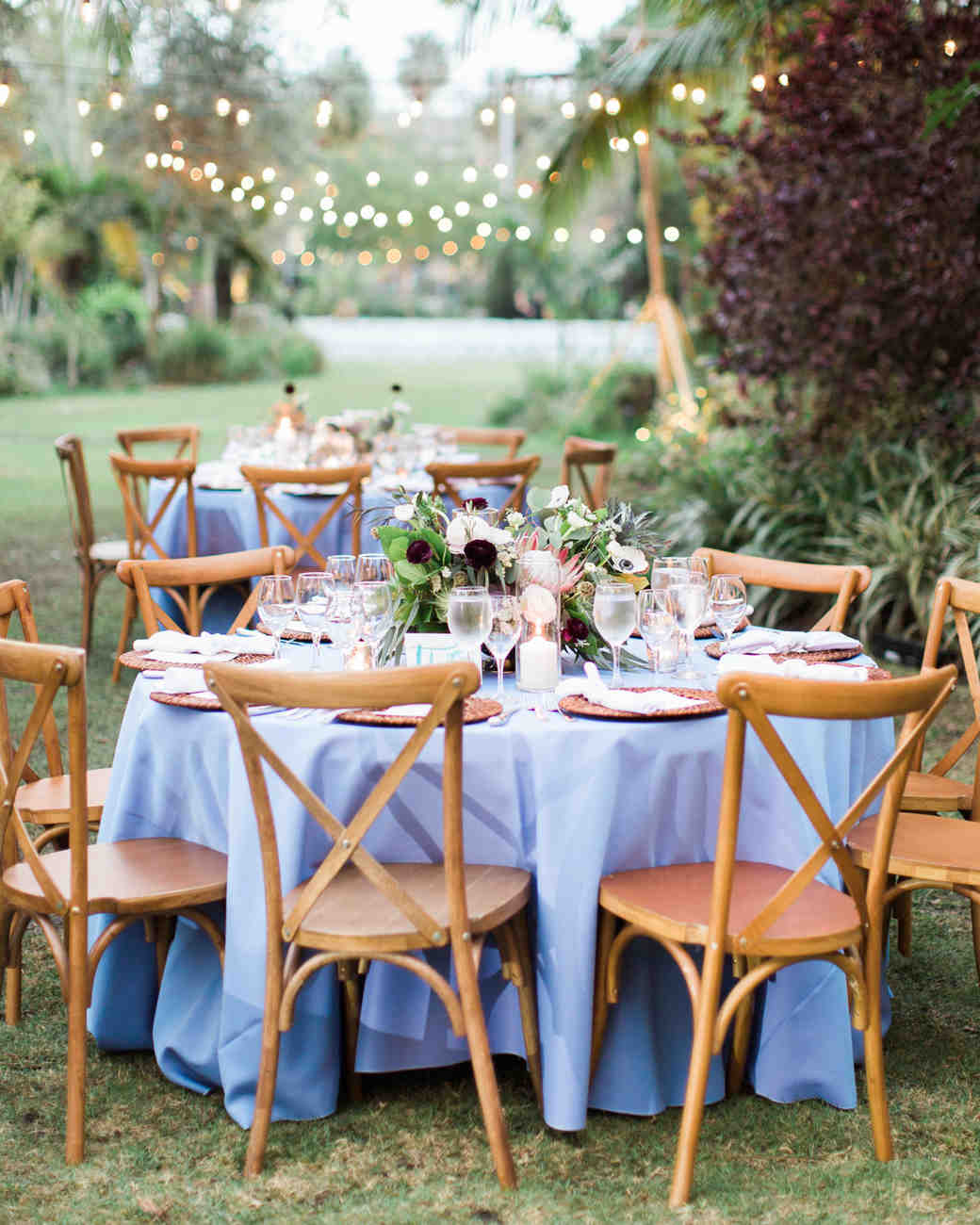 baby blue linen covered circular reception tables