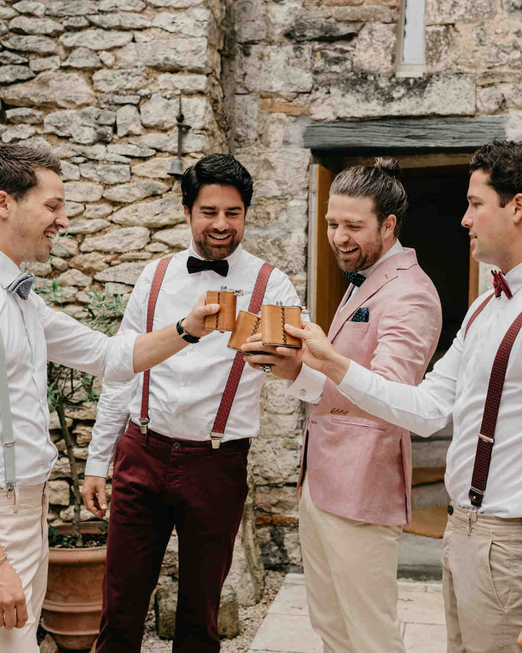 male wedding wedding guests cheers with flasks