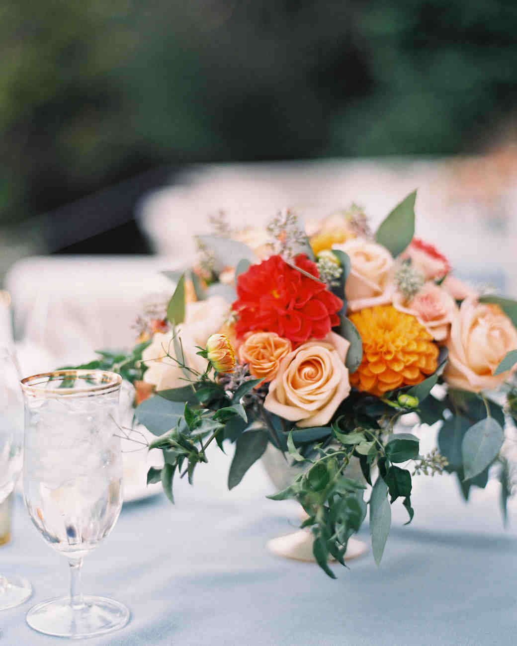 Garden wedding centerpiece with roses and dahlias