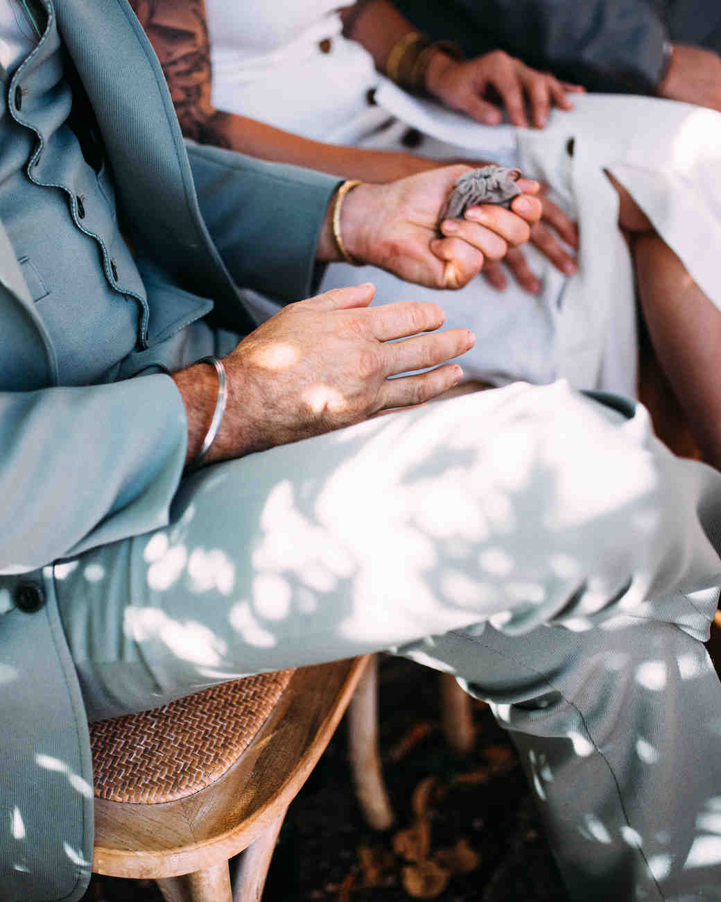 thomas jared wedding ceremony rings held by guests