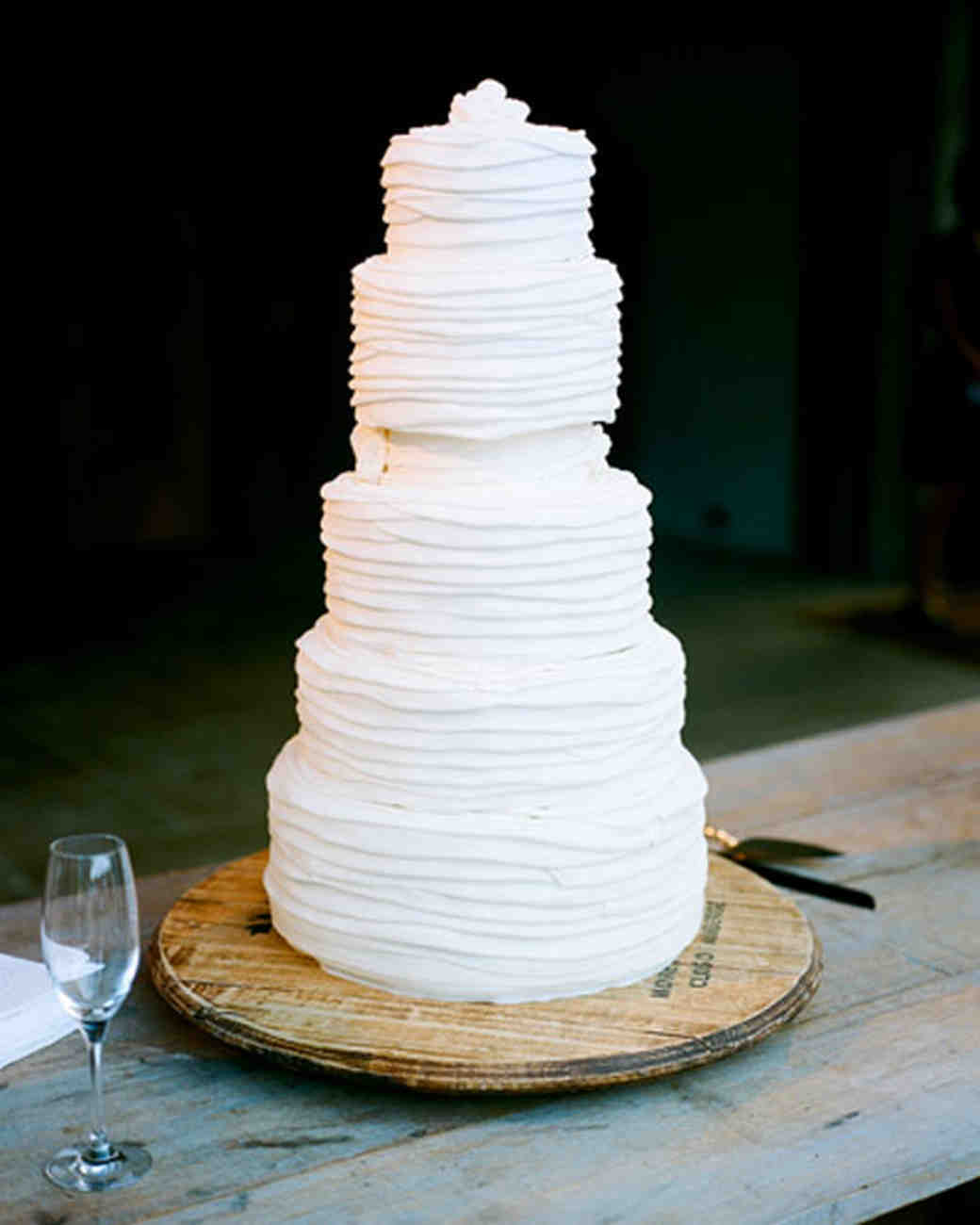 Five-Tiered Rustic White Wedding Cake with Lined Icing