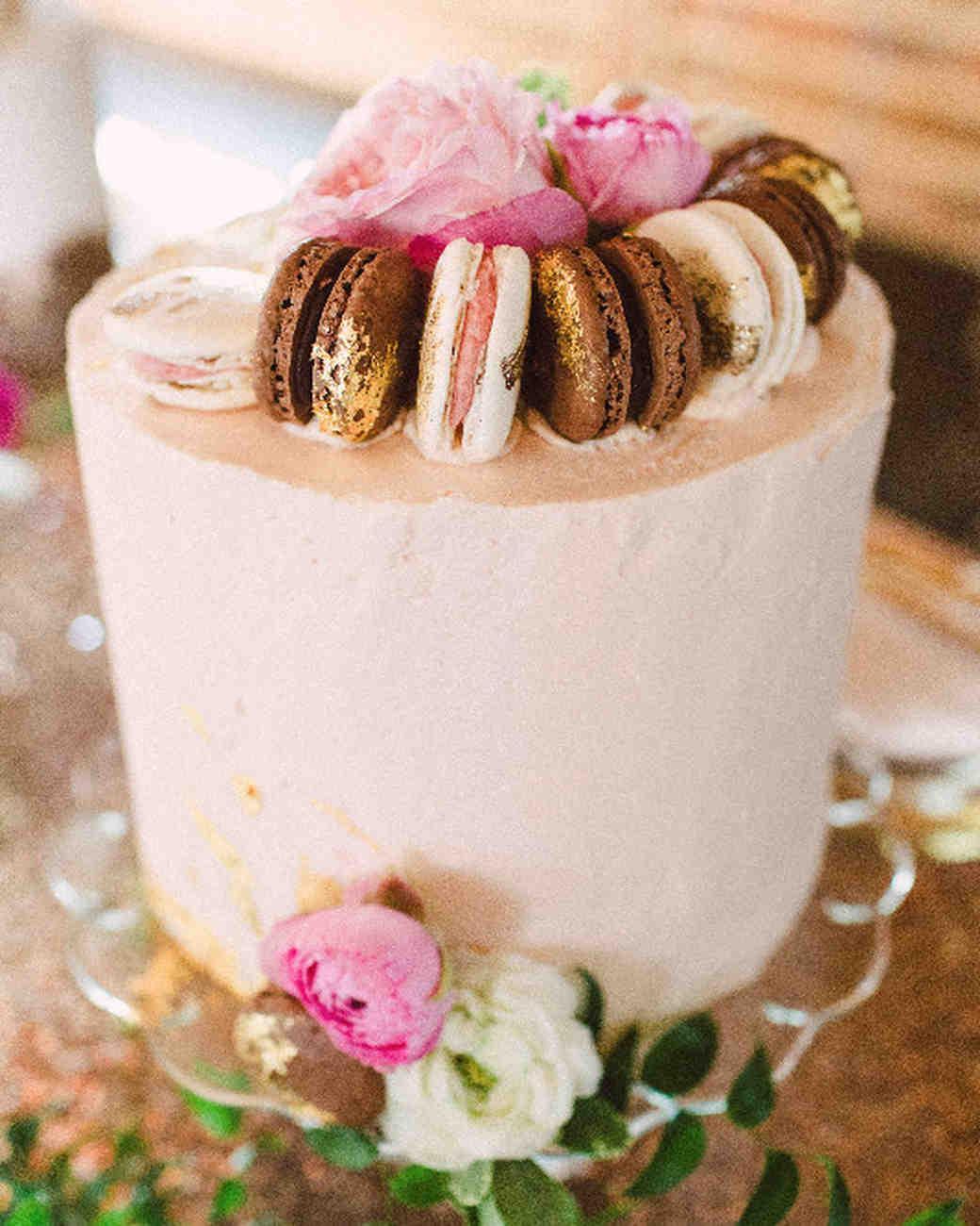 wedding cake topped with macarons